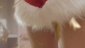 Close up of woman bare legs dancing in throwing confetti. In full HD stock video