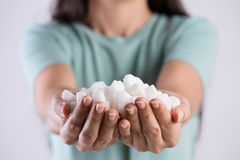 Close up woman beautiful hands holding white sugar cubes. Healthcare concept.  royalty free stock photo