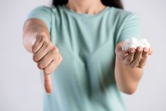 Close up woman beautiful hands holding white sugar cubes with thumbs down. Healthcare concept.  royalty free stock images