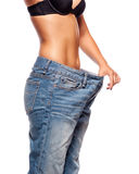 Close up of a woman belly in too big pants Stock Photography