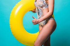 Close up woman in bikini with inflatable ring isolated on green background. Close up woman in bikini with inflatable ring isolated on green Royalty Free Stock Photos