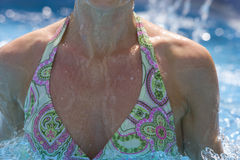 Close up of woman in bikini in swimming pool Royalty Free Stock Photography