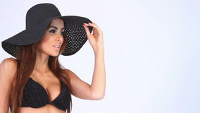 Close up of a woman in black bikini and hat on white stock video
