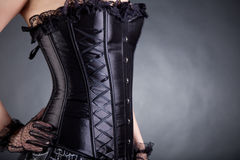 Close-up of woman in black corset Royalty Free Stock Photography