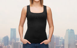 Close up of woman in blank black tank top Royalty Free Stock Photo