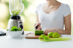 Close up of woman with blender chopping vegetables Royalty Free Stock Photography