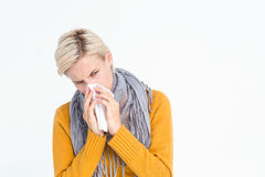 Close up of woman blowing her nose. With a tissue Stock Photo