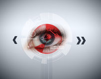Close up of woman blue eye with red analysis Stock Photography
