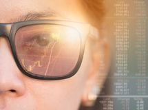 Close up of woman with blue eyes wearing the glasses. Looking on the waveform lines expressed concept of stock market,augmented reality, technology, stock Royalty Free Stock Image