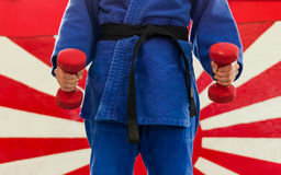Close Up of Woman in Blue Judo Gi, and Black Belt, which is Trai Royalty Free Stock Photography