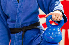 Close Up of Woman in Blue Judo Gi, and Black Belt, which is Trai Royalty Free Stock Image
