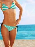 Close-up of woman body in bikini. On the ocean beach Royalty Free Stock Photos