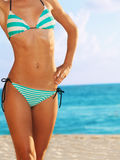 Close-up of woman body in bikini. On the ocean beach Stock Images