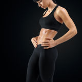 Close up of woman body strong abs showing