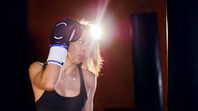Close up of the woman boxing with punching bags. stock video