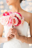 Close up of woman or bride with flower bouquet stock image