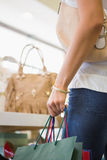Close up of woman browsing bags Royalty Free Stock Photo