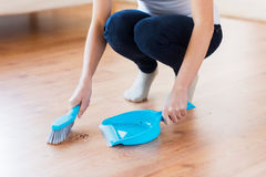 Close up of woman with brush and dustpan sweeping Stock Photos