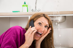 Close-up Of Woman Calling To Plumber royalty free stock photos