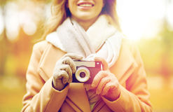 Close up of woman with camera in autumn park Royalty Free Stock Photo