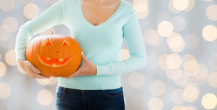 Close up of woman with carved halloween pumpkin Stock Photography