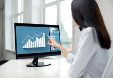 Close up of woman with chart on computer in office Royalty Free Stock Image