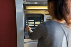 Close up of woman choosing option on atm machine Royalty Free Stock Photos