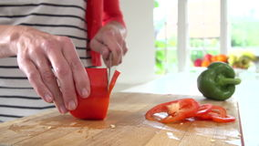 Close Up Of Woman Chopping Peppers On Wooden Board stock video
