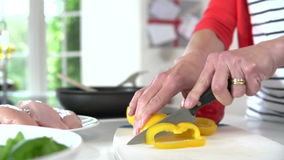 Close Up Of Woman Chopping Peppers On Wooden Board Royalty Free Stock Photo