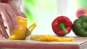 Close Up Of Woman Chopping Peppers On Wooden Board Royalty Free Stock Image