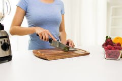 Close up of woman chopping strawberry at home Stock Images