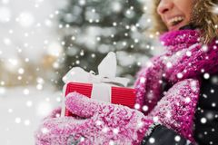 Close up of woman with christmas gift outdoors royalty free stock photos