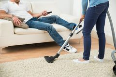 Close-up of a woman cleaning carpet Royalty Free Stock Images