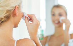 Close up of woman cleaning face at bathroom Stock Photos