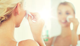 Close up of woman cleaning face at bathroom Royalty Free Stock Photo