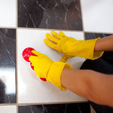 Close up of a woman cleaning the floor Royalty Free Stock Photos