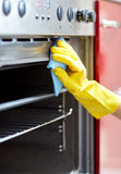Close up of woman cleaning oven at home kitchen Royalty Free Stock Photos
