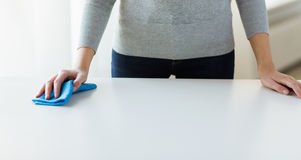 Close up of woman cleaning table with cloth Stock Photos