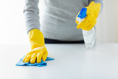 Close up of woman cleaning table with cloth Stock Image