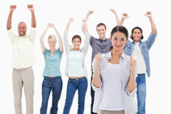 Close-up of a woman clenching her fists with people raising thei Royalty Free Stock Images