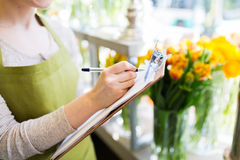 Close up of woman with clipboard at flower shop Stock Photography