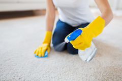 Close up of woman with cloth cleaning carpet Royalty Free Stock Photography
