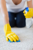 Close up of woman with cloth cleaning carpet Stock Photography