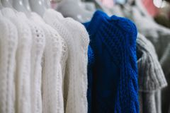 Close up on woman clothes in the shopping center Royalty Free Stock Photos