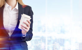 Close up of woman with coffee in blue office Stock Images