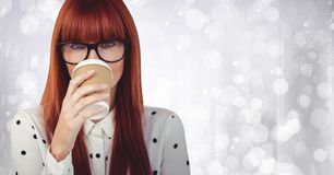 Close up of woman with coffee cup over face against white bokeh Stock Image