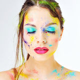 Close up of woman with colored paint on face Royalty Free Stock Photo