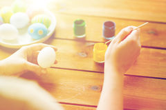 Close up of woman coloring easter eggs Royalty Free Stock Photo