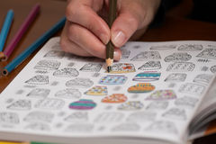 Adult coloring a stress release book Stock Photos