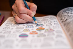 Adult coloring a stress release book Stock Image